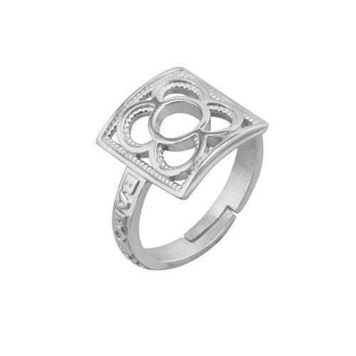 anillo de plata con flor